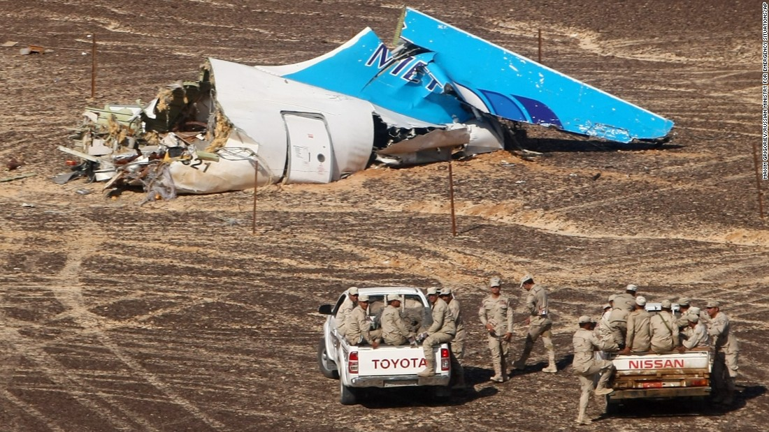 Members of the Egyptian military approach the wreckage of a Russian passenger plane Sunday, November 1, in Hassana, Egypt. lt;a href=quot;http://www.cnn.com/2015/10/31/world/gallery/russian-plane-crash/index.htmlquot; target=quot;_blankquot;gt;The plane crashedlt;/agt; the day before, killing all 224 people on board. ISIS claimed responsibility for downing the plane, but the groups claim wasnt immediately verified.