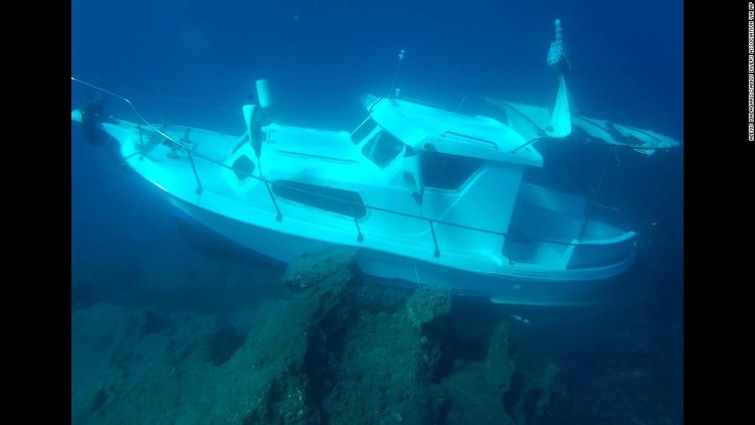The Kusadasi Ilgun, a sunken 20-foot boat, lies in waters off the Greek island of Samos on Sunday, November 1.