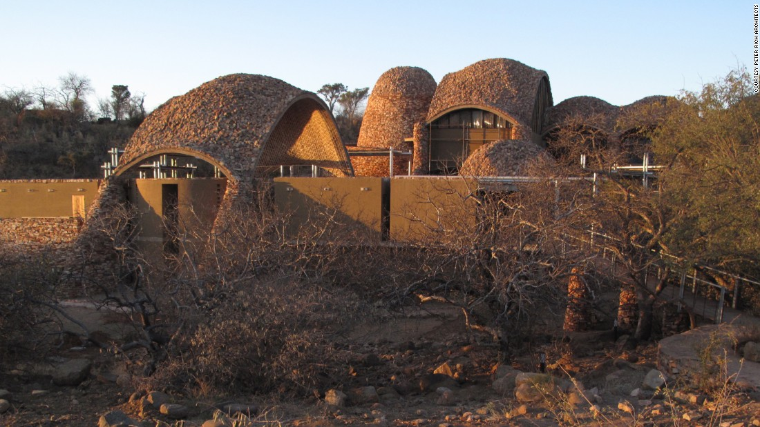 "Mapungubwe Interpretation Centre is a cultural building designed to host ancient South African artifacts. Described as a ""poverty relief project using ecological methods and materials"" the architects sourced local materials (such as local pressed soil cement tiles) for building and turned to local labor forces for construction in an effort to help the community."