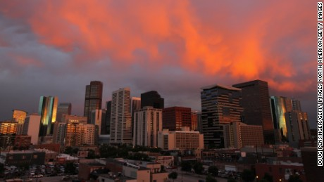 DENVER, CO - JULY 14:  Turbulent weather produced a spectacular sunset over the skyline of the Denver downtown as seen from the stadium as the Milwaukee Brewers face the Colorado Rockies at Coors Field on July 14, 2011 in Denver, Colorado.  (Photo by Doug Pensinger/Getty Images)