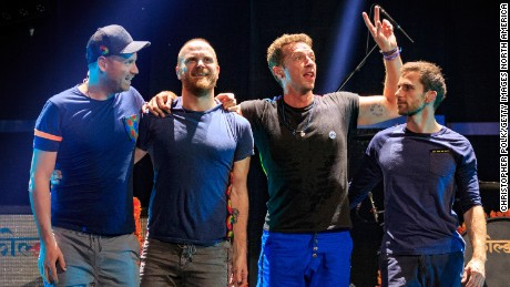 (L-R) Guitarist Jonny Buckland, drummer Will Champion, frontman Chris Martin and bassist Guy Berryman of Coldplay take a bow after performing onstage at the 2015 iHeartRadio Music Festival at MGM Grand Garden Arena on September 18, 2015 in Las Vegas, Nevada. (Photo by Christopher Polk/Getty Images for iHeartMedia)