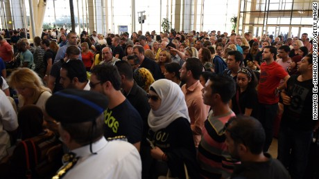 Tourists queue at the airport in Egypt's Red Sea resort of Sharm El-Sheikh Friday.