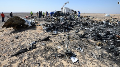 In this Russian Emergency Situations Ministry photo, made available on Monday, Nov. 2, 2015 Russian and Egyptian experts work at the crash site of a Russian passenger plane bound for St. Petersburg in Russia that crashed in Hassana, Egypt's Sinai Peninsula, on Monday, Nov. 2, 2015. A Russian cargo plane on Monday brought the first bodies of Russian victims home to St. Petersburg, from Egypt.(Russian Ministry for Emergency Situations photo via AP)