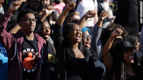 'Students cheer while listening to members of the black student protest group Concerned Student 1950 speak following the announcement that University of Missouri System President Tim Wolfe would resign Monday, Nov. 9, 2015, at the university in Columbia, Mo. Wolfe resigned Monday with the football team and others on campus in open revolt over his handling of racial tensions at the school. (AP Photo/Jeff Roberson)' from the web at 'http://i2.cdn.turner.com/cnnnext/dam/assets/151110064705-01-mizzou-protest-1110-large-169.jpg'
