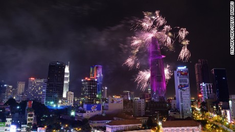 Fireworks light up the sky over the centre of Ho Chi Minh City (former Saigon) late on April 30, 2015 as part of celebrations marking the 40th anniversary of the fall of Saigon. Vietnam marked the 40th anniversary of Saigon's fall with a huge military parade to celebrate the moment communist forces ended a decades-long conflict and delivered a painful blow to American moral and miliary prestige. AFP PHOTO /  STR        (Photo credit should read STR/AFP/Getty Images)
