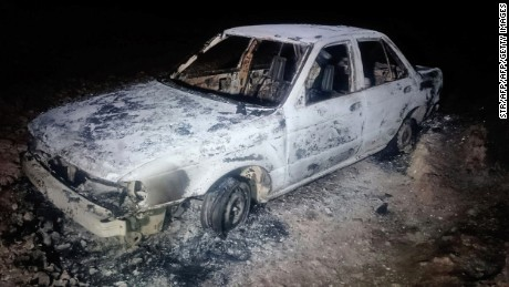 A burned down car remains at the crime scene where six people were executed by gunmen in Tetitlan de Las Limas, Chilapa, Guerrero state, Mexico on November 10, 2015.  Six people were killed in a violent Mexican town of Guerrero (south), five of the victims belonged to the family of a controversial former chief of police and including two children aged seven and one years and their mother, said Tuesday the state police .This brutal murder occurred on Monday joined the Sunday day of violence in Guerrero, where 16 people were killed, 12 in a clash in a cockfight and four in a sports after a football match. AFP PHOTO/ STRSTR/AFP/Getty Images
