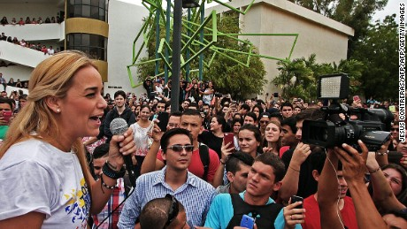 """Lilian Tintori (R), wife of jailed Venezuelan opposition leader Leopoldo Lopez, speaks during rally in Maracaibo, Zulia state, Venezuela on October 26, 2015. A Venezuelan prosecutor who called the conviction and imprisonment of Lopez a """"farce"""" has been fired, the country's attorney general said Monday.  AFP  PHOTO/JESUS CONTRERASJESUS CONTRERAS/AFP/Getty Images"""