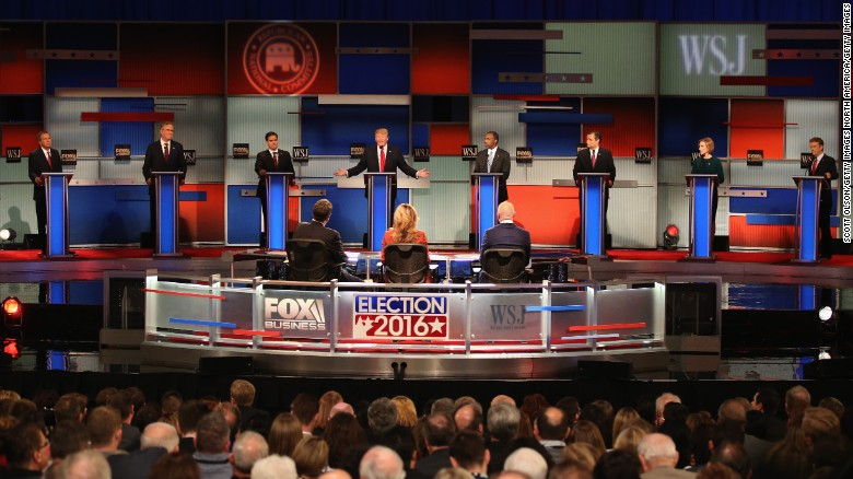 MILWAUKEE, WI - NOVEMBER 10:  Presidential candidate Donald Trump (4th L) speaks with Ohio Governor John Kasich (L-R), Jeb Bush, Sen. Marco Rubio (R-FL), Ben Carson, Ted Cruz (R-TX), Carly Fiorina, and Sen. Rand Paul (R-KY)  take part in the Republican Presidential Debate sponsored by Fox Business and the Wall Street Journal at the Milwaukee Theatre November 10, 2015 in Milwaukee, Wisconsin. The fourth Republican debate is held in two parts, one main debate for the top eight candidates, and another for four other candidates lower in the current polls.  (Photo by Scott Olson/Getty Images)