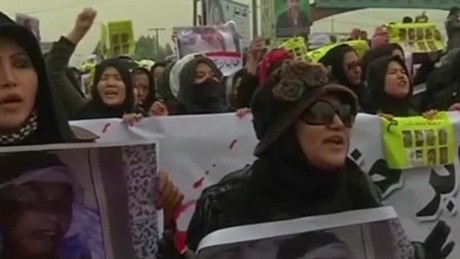 'Thousands of Afghans protest Hazara beheadings' from the web at 'http://i2.cdn.turner.com/cnnnext/dam/assets/151111073919-protesters-call-for-afghan-leaders-to-resign-bpr-00014603-large-169.jpg'