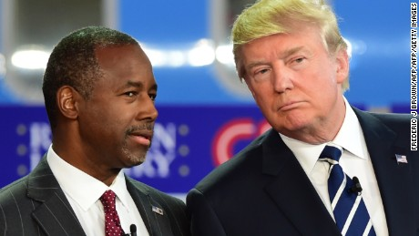 Republican presidential hopefuls Ben Carson (L) and Donald Trump look on during the Republican Presidential Debate at the Ronald Reagan Presidential Library in Simi Valley, California, September 16, 2015. Republican presidential candidates collectively turned their sights on frontrunner Donald Trump at the party's second debate, taking aim at his lack of political experience and his sometimes abrasive style. AFP PHOTO / FREDERIC J BROWN        (Photo credit should read FREDERIC J BROWN/AFP/Getty Images)