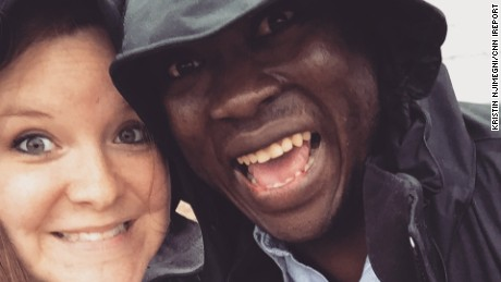Njimegni and Eric take a selfie in the rain. The couple meet in Moscow while studying and working aboard and now reside in Keewatin, Minnesota.