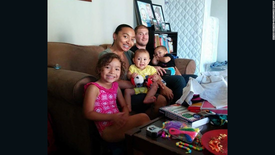 Daniel and Natalie Martinez-Vlasoff pose with their three children in their home in Los Angeles in 2014. The couple welcomed a fourth child in November.