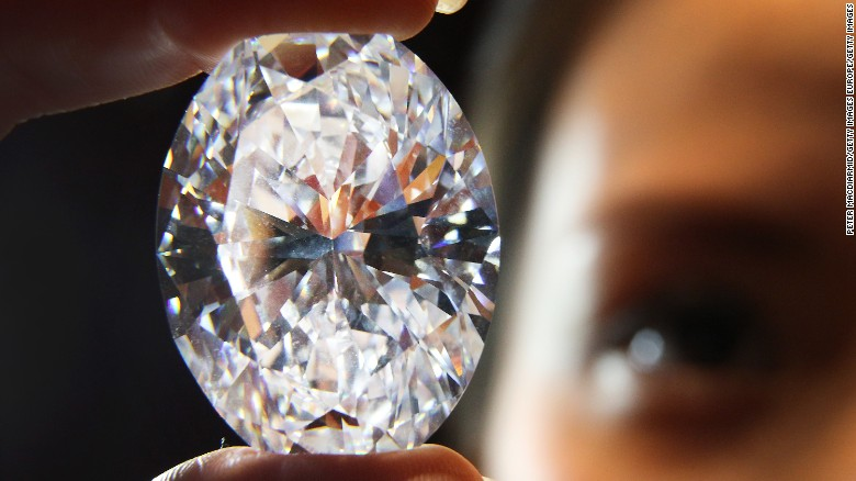 A Sotheby's employee holds huge white oval diamond that was auctioned in 2013. Scientists have created a substance that can now outmatch a diamond in hardness and brilliance.