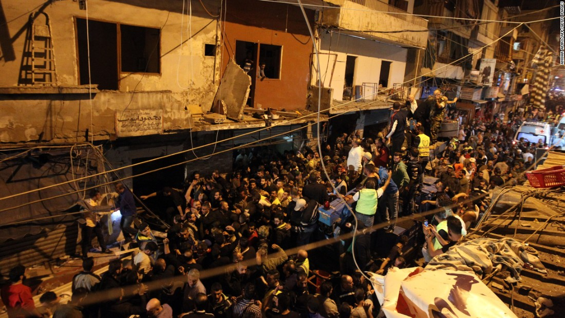 "Emergency personnel and civilians gather at the site of a <a href=""http://www.cnn.com/2015/11/12/middleeast/beirut-explosions/index.html"" target=""_blank"">twin suicide bombing</a> in the southern suburbs of the capital Beirut on Thursday, November 12. The two bombings killed at least 41 people and wounded over 200 more Thursday evening in southern Beirut, Lebanese Health Minister Wael Abu Faour said."