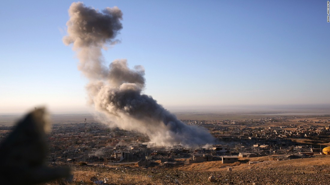 Smoke rises over the northern Iraqi town of Sinjar on November 12. Kurdish Iraqi fighters, backed by a U.S.-led air campaign, lt;a href=quot;http://www.cnn.com/2015/11/13/middleeast/iraq-free-sinjar-isis/quot; target=quot;_blankquot;gt;retook the strategic town, lt;/agt;which ISIS militants overran last year. ISIS wants to create an Islamic state across Sunni areas of Iraq and Syria.