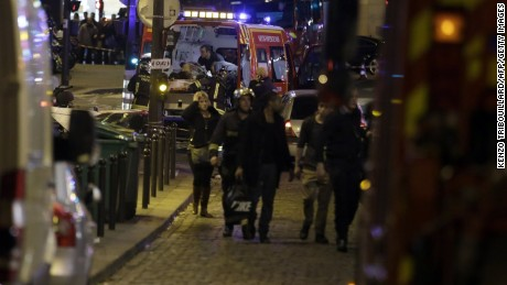 'Security moves people along Rue Bichat following a string of attacks in the French capital Paris on November 13, 2015. At least 18 people were killed as multiple shootings and explosions hit Paris Friday, police said. Police also said there was an ongoing hostage crisis in the Bataclan a concert hall in the French capital. AFP PHOTO / KENZO TRIBOUILLARDKENZO TRIBOUILLARD/AFP/Getty Images' from the web at 'http://i2.cdn.turner.com/cnnnext/dam/assets/151113164939-04-paris-shooting-1113-large-169.jpg'