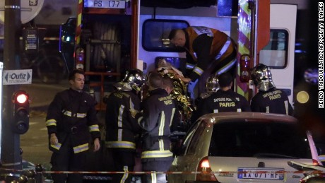 'An injured man is put into an ambulance following an attack in the 10th arrondissement of the French capital Paris,on November 13, 2015. At least 18 people were killed as multiple shootings and explosions hit Paris, police said. Police also said there was an ongoing hostage crisis in the Bataclan a concert hall in the French capital. AFP PHOTO / KENZO TRIBOUILLARDKENZO TRIBOUILLARD/AFP/Getty Images' from the web at 'http://i2.cdn.turner.com/cnnnext/dam/assets/151113170653-07-paris-shooting-1113-large-169.jpg'