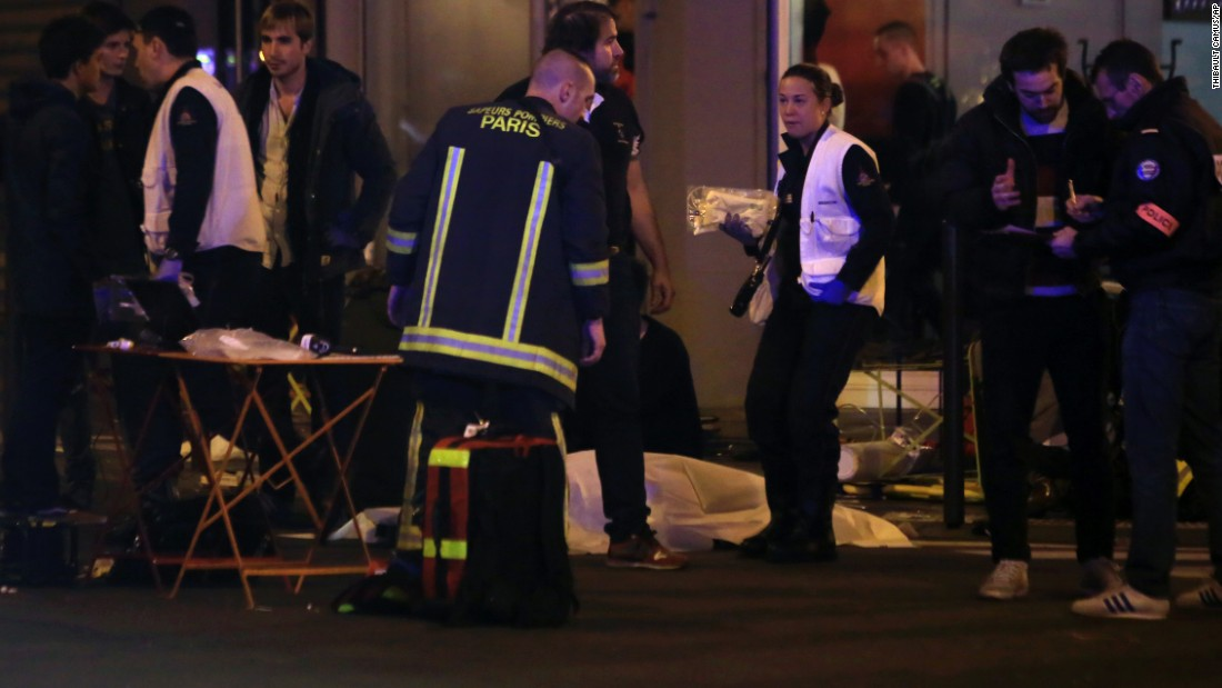 Rescue workers and medics tend to victims at the scene of one of the shootings, a restaurant in the 10th District. Paris police told CNN there were at least three attacks. Attackers reportedly used AK-47 automatic weapons, and there were explosions at the Stade de France.