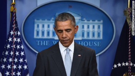 'US. President Barack Obama looks down as he speaks to the press in Washington, DC on November 13, 2015, after being informed about a series of deadly attacks that rocked Paris. At least 35 people were killed as multiple shootings and explosions hit Paris, police said.' from the web at 'http://i2.cdn.turner.com/cnnnext/dam/assets/151113181452-barack-obama-november-13-2015-large-169.jpg'