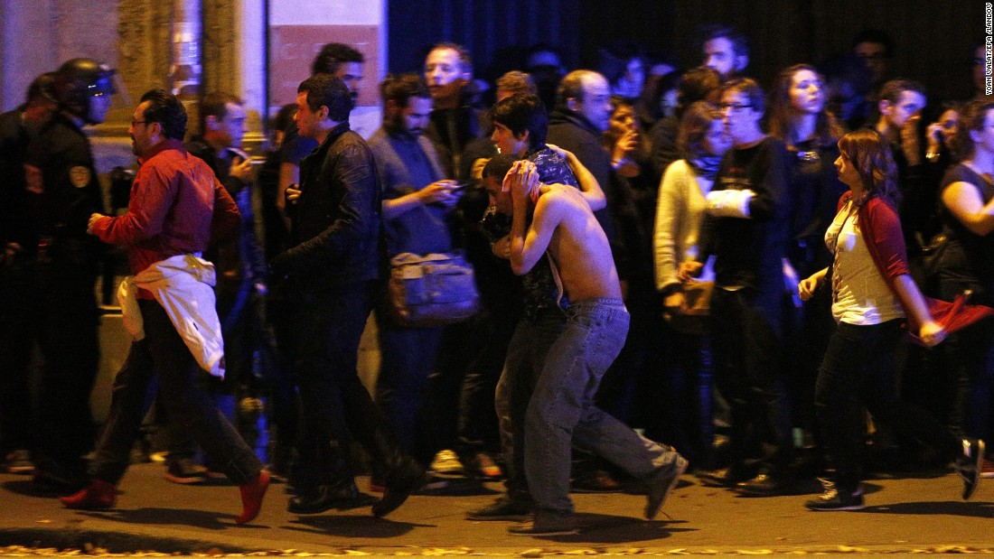 Wounded people are evacuated outside the scene of a hostage situation at the Bataclan theater in Paris on Friday, November 13.