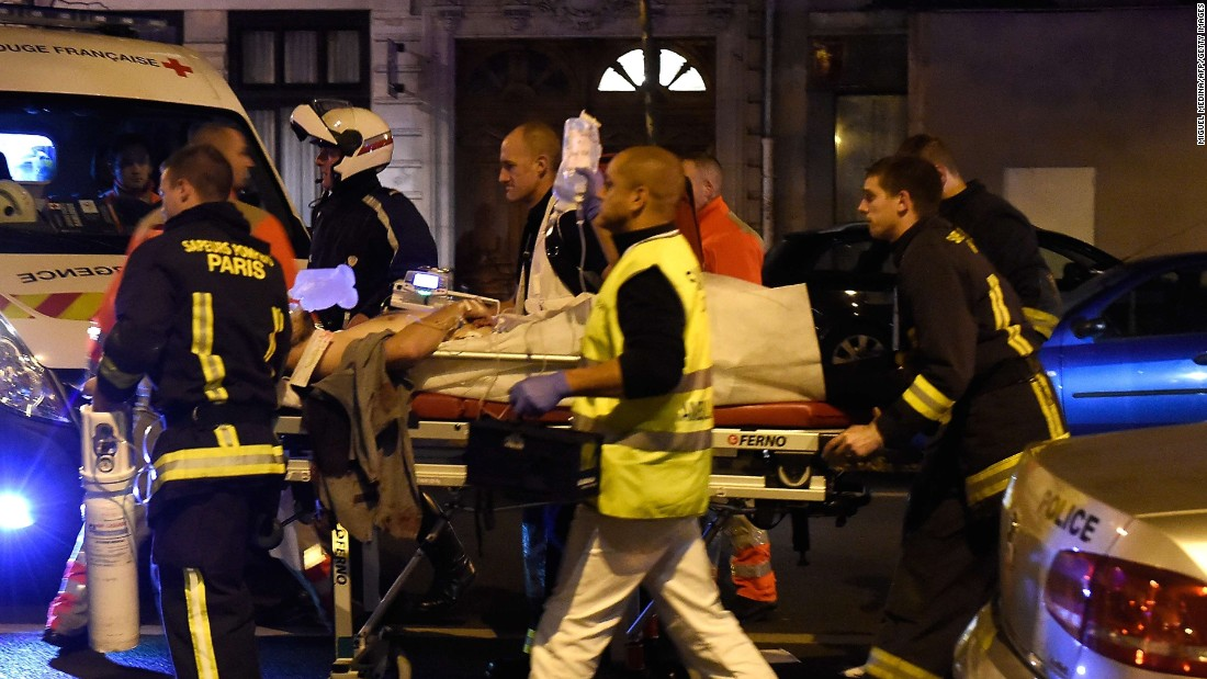 Rescuers evacuate an injured person on Boulevard des Filles du Calvaire, close to the Bataclan concert hall in central Paris.