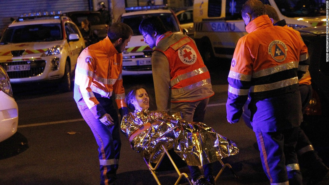 Medics evacuate an injured woman on Boulevard des Filles du Calvaire, close to the Bataclan theater, early on November 14.