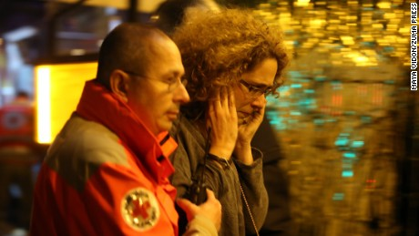 Nov. 14, 2015 - Paris, France - CORBIS OUT = Victims of the shooting at the Bataclan concert venue in central Paris are being evacuated to receive first aid. More than one hundred people were killed and many more wounded when gunmen opened fire inside the venue as the French capital has been the target of a series of deadly attacks. (Credit Image: © Maya Vidon-White via ZUMA Wire)