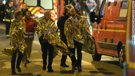 'People are being evacuated on rue Oberkampf near the Bataclan concert hall in central Paris, early on November 14, 2015. At least 120 people were killed in a series of terror attacks in Paris on November 13 according to a provisional total, a source close to the investigation said. AFP PHOTO / MIGUEL MEDINAMIGUEL MEDINA/AFP/Getty Images' from the web at 'http://i2.cdn.turner.com/cnnnext/dam/assets/151113221500-28-paris-shooting-1113-large-169.jpg'