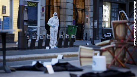 A forensic scientist inspects outside of the Cafe Bonne Biere on Rue du Faubourg du Temple in Paris on November 14, following a series of coordinated attacks in and around Paris late Friday, which left more than 120 people dead. According to witnesses, at least 5 people were killed in the immediate area by attackers wielding automatic rifles.