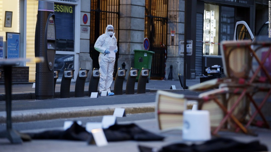 A forensic scientist works near Cafe Bonne Biere on Rue du Faubourg du Temple in Paris on November 14, following a series of coordinated attacks in and around Paris late Friday. According to witnesses, at least five people were killed in the immediate area by attackers wielding automatic rifles.