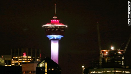 The Calgary Tower is lit up with the colors of the French flag to show support and sympathy for victims of the Paris attacks in Calgary, Alberta on November 13.