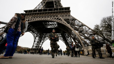 French soldiers patrol the area at the foot of the Eiffel Tower in Paris on November 14, 2015 following a series of coordinated attacks in and around Paris late Friday.