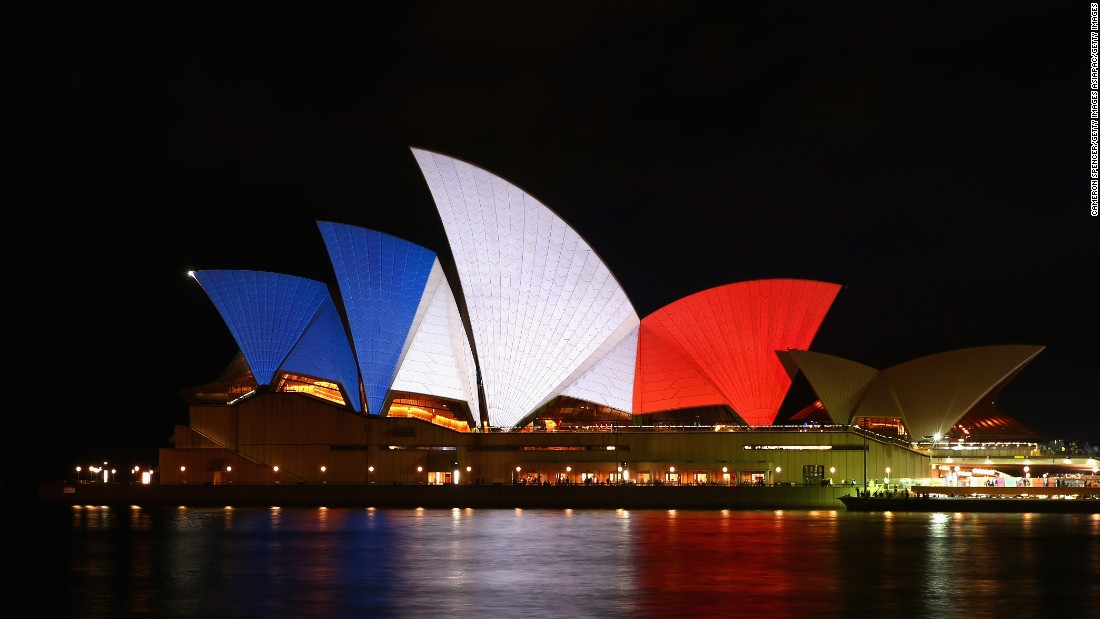 "<a href=""http://www.cnn.com/2015/11/14/world/paris-attacks-tributes-irpt/index.html"">As a sign of solidarity</a>, Australia's Sydney Opera House is illuminated in the colors of the French flag on November 14."