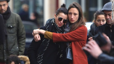 'Women comfort each other as they stand in front of the Carillon cafe, in Paris, Saturday, November 14 following Friday's terror attacks.' from the web at 'http://i2.cdn.turner.com/cnnnext/dam/assets/151114084009-14-paris-attacks-1114-large-169.jpg'