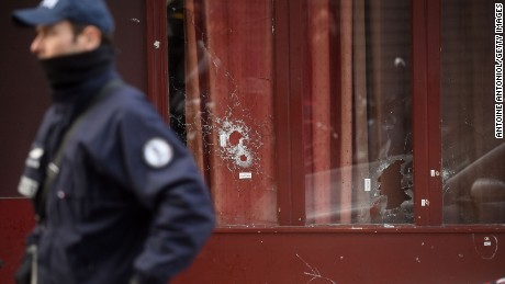 Bullet holes are seen on the windows of Le Carillon bar, the day after a deadly attack on November 14 in Paris, France.