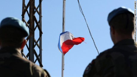 French soldiers of the United Nations Interim Forces in Lebanon (UNIFIL) observe the national flag at half mast at the contingent headquarters in the southern Lebanese village of Deir Kifa on November 14, 2015, following a series of coordinated attacks in and around the French capital Paris late November 13 which left more than 120 people dead. AFP PHOTO / MAHMOUD ZAYYAT        (Photo credit should read MAHMOUD ZAYYAT/AFP/Getty Images)
