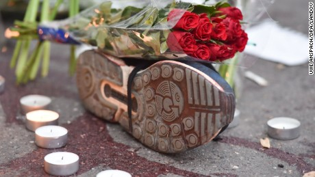 'Image #: 40824580    Red roses on a sports shoe, next to a trail of blood, outside the Bataclan music club in Paris, France, 14 November 2015. At least 120 people have been killed in a series of terrorist attacks in Paris. PHOTO: UWE ANSPACH/DPA     DPA /LANDOV' from the web at 'http://i2.cdn.turner.com/cnnnext/dam/assets/151114132810-13-paris-attacks-1114---restricted-large-169.jpg'