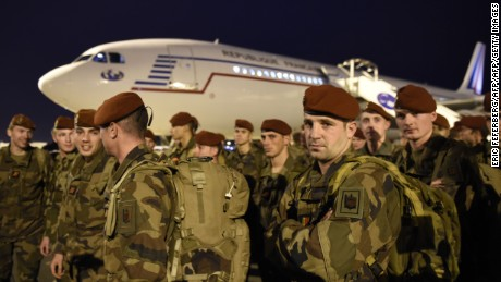 'Soldiers from the 3rd Marine Infantry Parachute Regiment (3e RPIMa) of Carcassonne are pictured upon their arrival at Paris' Charles de Gaulle airport as part of a reinforcement of security provisions, following a series of coordinated attacks in and around Paris on November 14, 2015 in Roissy-en-France. Islamic State jihadists claimed a series of coordinated attacks by gunmen and suicide bombers in Paris that killed at least 128 people in scenes of carnage at a concert hall, restaurants and the national stadium. AFP PHOTO/ERIC FEFERBERGERIC FEFERBERG/AFP/Getty Images' from the web at 'http://i2.cdn.turner.com/cnnnext/dam/assets/151114135854-03-paris-security-1114-large-169.jpg'