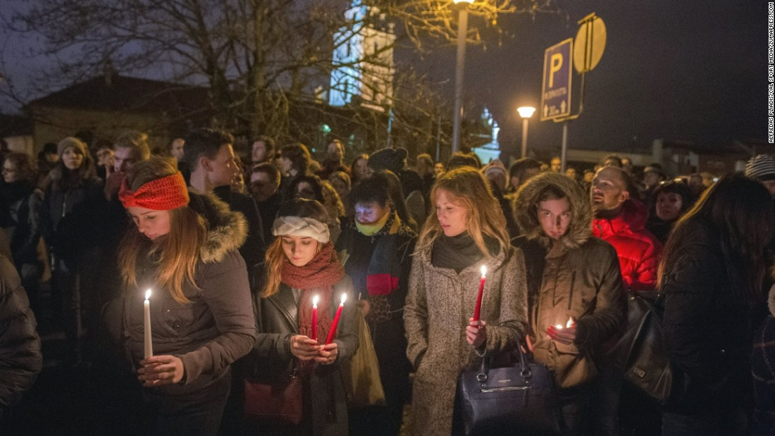 Lithuanians hold a candlelight vigil in front of the French Embassy in Vilnius, Lithuania, on November 14.
