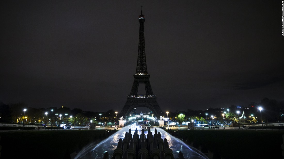 The Eiffel Tower stands dark as a mourning gesture on November 14, in Paris. More than 125 people were killed in a series of coordinated attacks in Paris on Friday. People around the world reacted in horror to the deadly terrorist assaults.