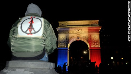 'The Washington Square Park arch is lit with the French national colors in solidarity with the citizens of France on November 14, 2015 in New York, a day after the Paris terrorist attacks. Islamic State jihadists claimed a series of coordinated attacks by gunmen and suicide bombers in Paris on November 13 that killed at least 129 people in scenes of carnage at a concert hall, restaurants and the national stadium. AFP PHOTO/JEWEL SAMADJEWEL SAMAD/AFP/Getty Images' from the web at 'http://i2.cdn.turner.com/cnnnext/dam/assets/151114212404-02-paris-peace-large-169.jpg'