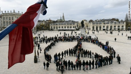 Image #: 40829488    Nancy 14 November 2015 - In the wake of deadly terrorist attacks in Paris, a human chain of 300 people formed the symbol of peace on the Place Stanislas in honor of the 128 victims and 300 injured.   Maxppp /Landov