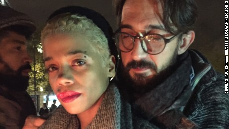 "LAURENT FARRE (40 years) and Paquita Mboni (30 years)  at La Republique Laurent ""Paquita can't talk, she's too upset.  This is like our 9/11. Our friend who was just having a drink after work is now in the hospital for no good reason.  In the United States I don't know if this would have happened.  People would have been able to defend themselves because they are allowed to carry guns.  We aren't, so we are defenseless. But we won't give in to fear.  It's not an option."""