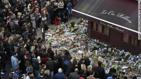 "People gather at a makeshift memorial in front of ""Le carillon"" restaurant on November 16, 2015, in the 10th district of Paris, following a series of coordinated terrorists attacks on November 13. Islamic State jihadists claimed a series of coordinated attacks by gunmen and suicide bombers in Paris that killed at least 128 people in scenes of carnage at a concert hall, restaurants and the national stadium. AFP PHOTO / ALAIN JOCARD        (Photo credit should read ALAIN JOCARD/AFP/Getty Images)"
