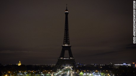 A picture taken on November 14, 2015 shows the Eiffel Tower with its lights turned off following the deadly attacks in Paris.