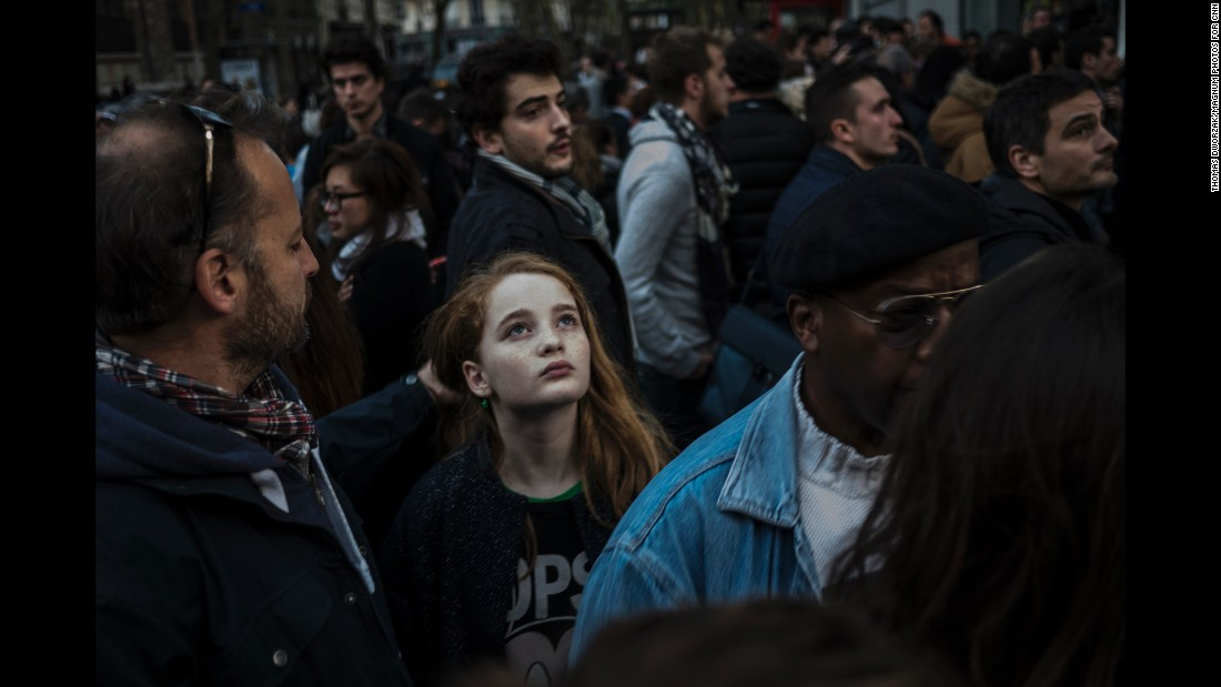 'A crowd gathers on Rue Charonne on November 15 near the site of one of the attacks.' from the web at 'http://i2.cdn.turner.com/cnnnext/dam/assets/151115205031-09-paris-aftermath-1115-super-169.jpg'
