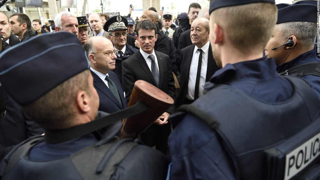 French Prime Minister Manuel Valls, center, speaks with police forces with French Interior minister Bernard Cazeneuve, left, and Defence Minister Jean-Yves Le Drian at the Gare du Nord railway station in Paris on November 15 about security measures after the attacks.