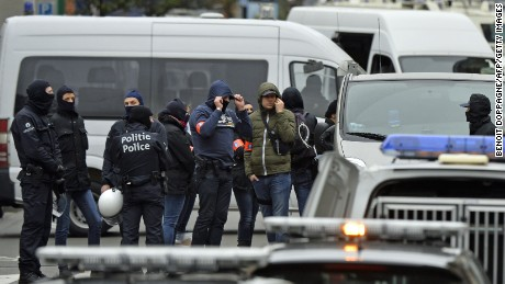 Police officers man a cordon as an operation takes place in the Molenbeek district of Brussels on November 16, 2015. Belgian police launched a major new operation in the Brussels district of Molenbeek, where several suspects in the Paris attacks had previously lived, AFP journalists said. Armed police stood in front of a police van blocking a street in the run-down area of the capital while Belgian media said officers had surrounded a house. Belgian prosecutors had no immediate comment.