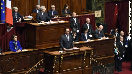 French President Francois Hollande (C) delivers a speech to members of Parliament during an exceptional joint gathering of Parliament in Versailles on November 16, 2015, three days after 129 people were killed in the worst terrorist attack in France's history.