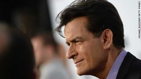 """HOLLYWOOD, CA - APRIL 11:  Actor Charlie Sheen arrives for the premiere of Dimension Films' """"Scary Movie 5"""" at ArcLight Cinemas Cinerama Dome on April 11, 2013 in Hollywood, California.  (Photo by Michael Buckner/Getty Images)"""